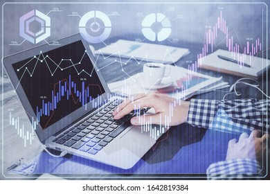 Double exposure of forex chart with man working on computer on background. Concept of market analysis. - Shutterstock ID 1642819384