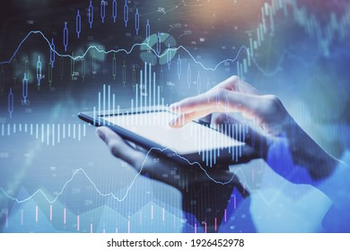 Double exposure of forex chart sketch hologram and woman holding and using a mobile device. Financial market concept.