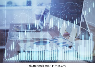 Double exposure of graph and financial info and work space with computer background. Concept of international online trading. - Shutterstock ID 1474265093
