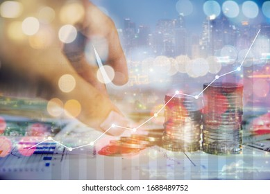 Double exposure of graph and rows of coins for finance and business investement concept