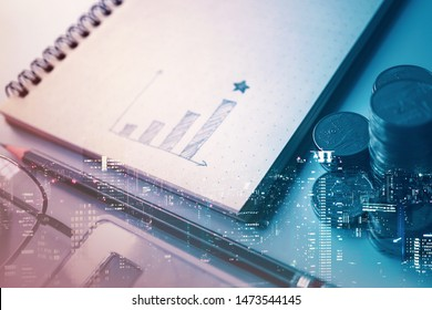 Double exposure of graph , stationary  and rows of coins for goal office ,  finance and business concept background