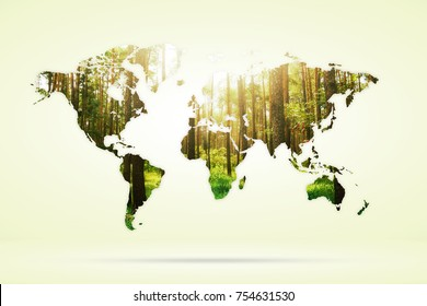 Double exposure of green forest and world map. Nature concept background