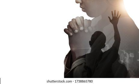 Double exposure of a hand girl praying and worship in the church, Hands folded in prayer concept for faith, spirituality and religion, Hands Raised In Worship background.