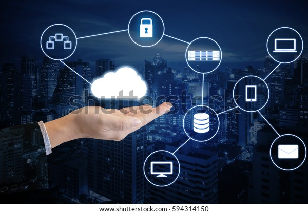 Double exposure hand of professional businessman connected internet and wireless network with his smart phone and city of business background in business trading and technology concept