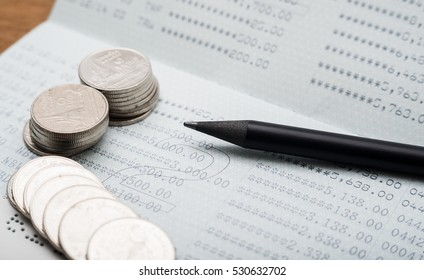 Double exposure hand with stack of coins and bank book, Saving money and account growth finance and banking business concept