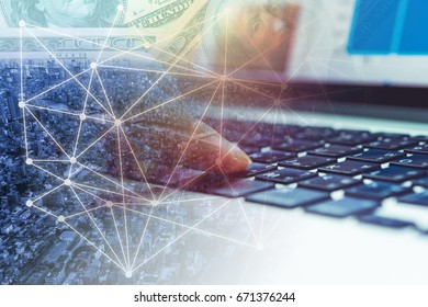 Double exposure hand using computer to purchase, invest or sell online on network business and graph trading background