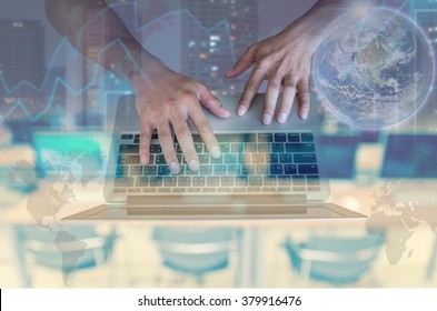 Double exposure of hand using the laptop with cityscape and financial graph on computer blurred background, Elements of this image furnished by NASA, education and business concept