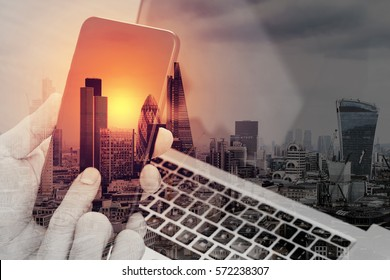 double exposure of hand using smart phone,laptop, online banking payment communication network technology 4.0,internet wireless application development sync app,London architecture city
