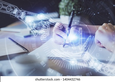 Double exposure of hands making notes with digital coding icons. Computer learning concept.