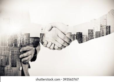 Double Exposure Handshake with Cityline Background