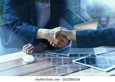 Double exposure of handshake and Digital techonology in business