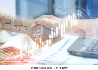 Double exposure of handshake and electronics circuits board,with business document.digital diagram chart and graph