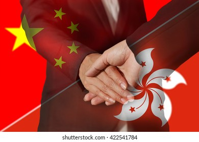 Double exposure of handshake, flag of China (PRC) and flag of Hong Kong as Good relationship concept