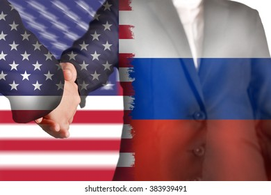 Double exposure of handshake with flag of the United States and  flag of Russia as agreement signed concept.