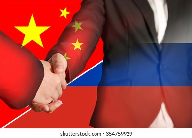 Double exposure of handshake on flag China and Russia as commitment and partnership concept.
