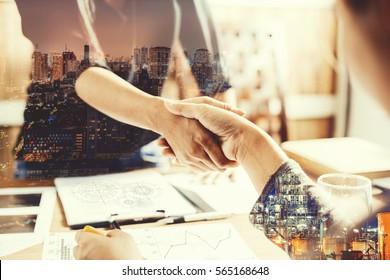 Double exposure of handshake,Close-up of businesswoman handshaking