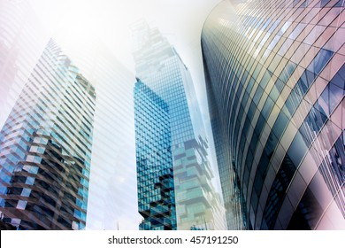 Double exposure high rise building Panoramic and perspective wide angle view to steel light blue background of glass  skyscraper commercial modern city of future. Business concept of success industry