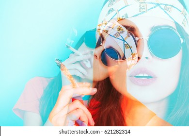 Double exposure of hippy girl smoking weed while wearing sunglasses