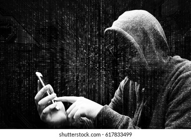 Double Exposure of hooded cyber crime hacker using mobile phone internet hacking in to cyberspace,online personal data security concept.Matrix code background. Black and white image.