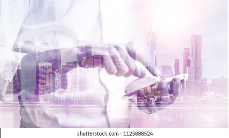 double exposure image of a business man using a phone during sunrise overlay with cityscape image. modern life and business concept