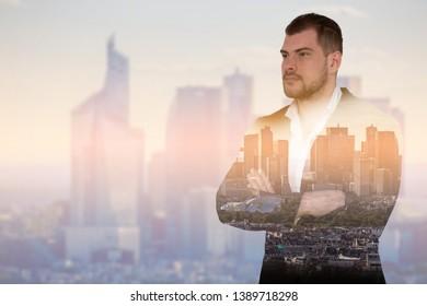 Double exposure image of businessman on cityscape background