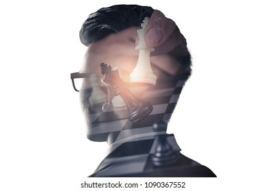 The double exposure image of the businessman standing overlay with chess game image and white copy space. the concept of strategic, planning, management, intelligence and education.