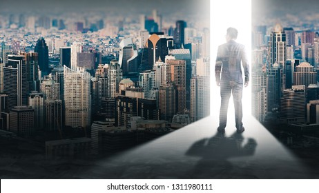 The double exposure image of the businessman standing front of the door is opening during sunrise overlay with cityscape image. The concept of modern life, business, city life and future.