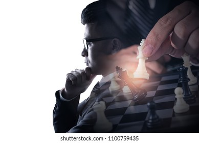 The double exposure image of the businessman thinking overlay with chess game image and white copy space. the concept of strategic, planning, management, intelligence and education.