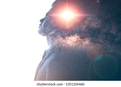 The double exposure image of the businessman thinking overlay with milky way galaxy image. the concept of imagination, technology, future and inspiration.