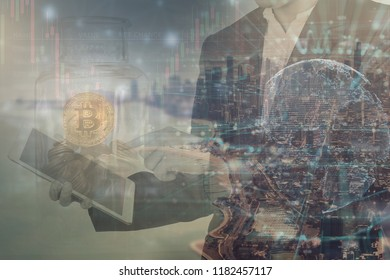 the double exposure image of businessman using tablet and business grap with cityscape,financial, economy and invesment