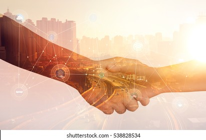 Double exposure of Image of businessmen hand shake, concept of network connection in urban life.