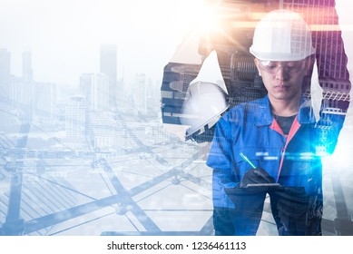 The double exposure image of the engineer standing during sunrise overlay with cityscape image. The concept of engineering, construction, city life and future.