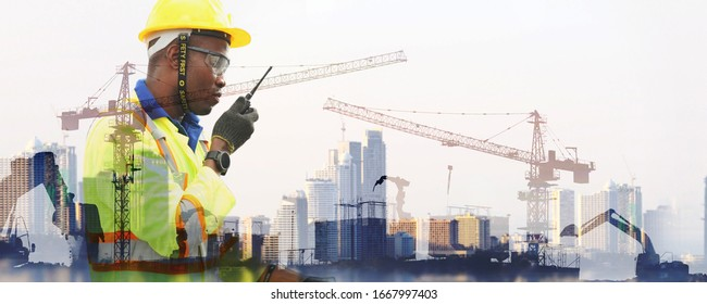 The double exposure image of the engineer standing on site, he is working at building construction area ,The concept of engineering, construction, city life and future.