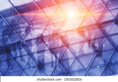 Double exposure image of faded business abstract background with office building and people conference group meeting showing partnership success of business deal.