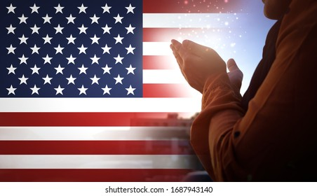 double exposure image, Hand praying for protection from corona virus on the American flag background