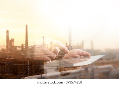 Double Exposure Image of Industrial Complex and Tablet