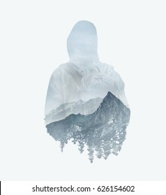 Double exposure image of male backpacker and mountains.