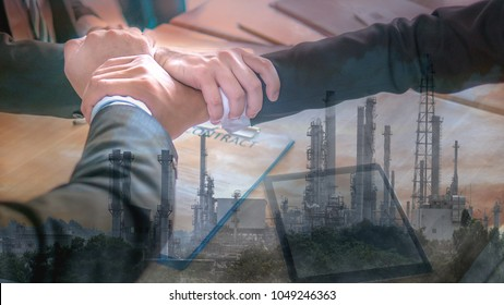 Double exposure image of three hands holding with background of Petrochemical refinery plants project in pollution smoke in concept of business cooperation that make pollution