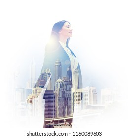 Double exposure of inspired woman in formals and cityscape of Dubai