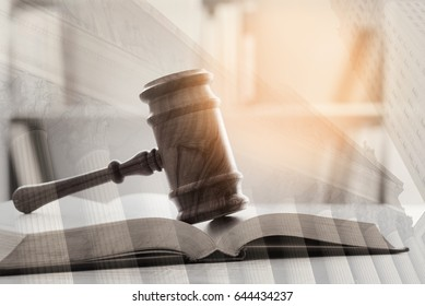 Double exposure of Judge gavel, law books and courthouse background. Concept of law, legal.