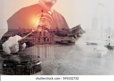 Double exposure of justice and law concept.Male judge in a courtroom with the gavel and working with holy book and brass scale on wood table with London city