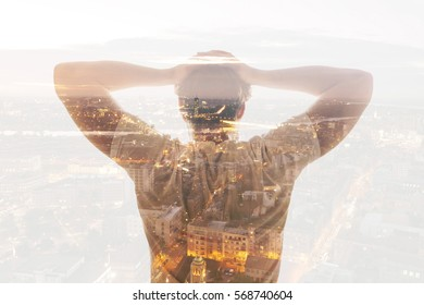 Double exposure of man and city