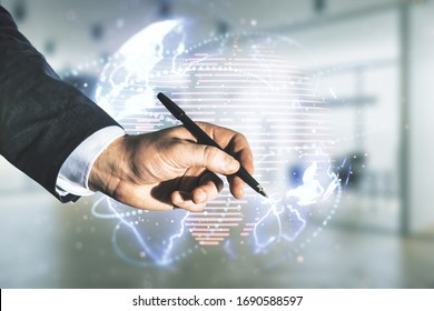 Double exposure of man hand with pen working with abstract digital world map hologram with connections on blurred office background, big data and blockchain concept