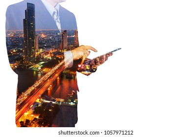 Double Exposure of Man or Male hold Digital Wireless Tablet with City Building Business Street as High Speed Data Technology Innovation Networking and Real Estate ProJect Development Concep