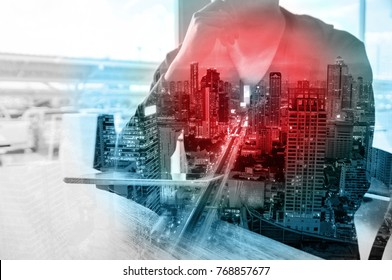 Double Exposure of Man or Male hold Digital Wireless Tablet with City Building Business Street as High Speed Data Technology Innovation Networking and Real Estate ProJect Development Concept.