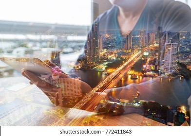 Double Exposure of Man or Male hold Digital Smart Tablet with City Building Business Street and Bridge as High Speed Data Technology Innovation Networking and Real Estate ProJect Development Concept