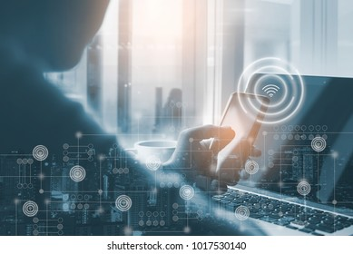 Double exposure of man programer or software developer working on laptop computer and using mobile smart phone, start up business, blue tone, software development, internet of things IoT concept