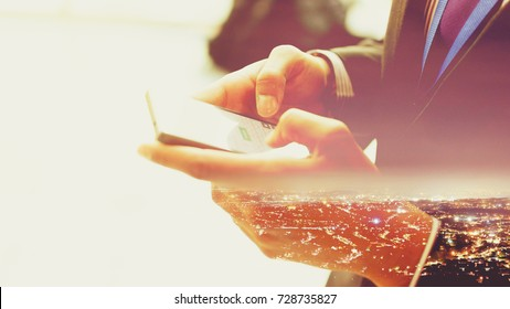 Double Exposure of a man using Smartphone, Businessman in Smart Suit using Modern Technology, Close up Shallow Depth of Field Haze Horizontal Photography