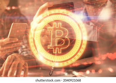 Double exposure of man and woman on-line shopping holding a credit card and crypto theme hologram drawing. Blockchain and E-commerce pay on-line concept.