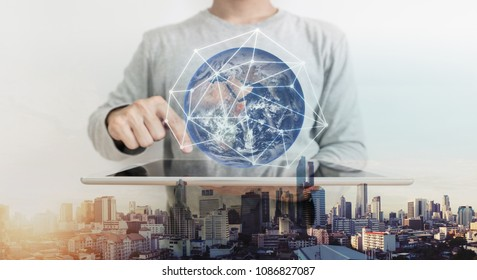 Double exposure, a man working on digital tablet and global network connection hologram technology. Element of this image are furnished by NASA